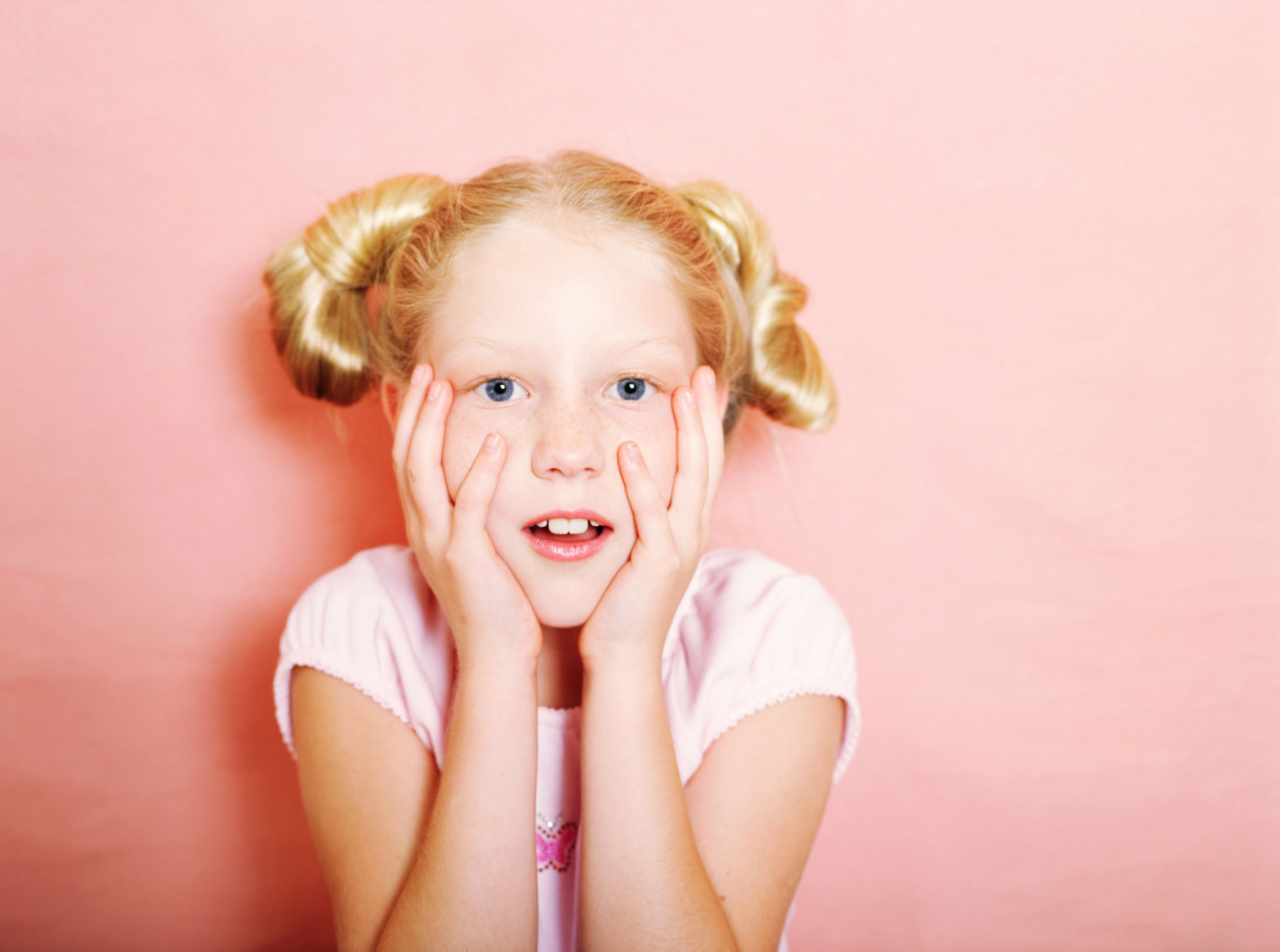 expressive blond girl with pigtails